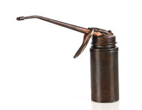 Old oil can. Worn and dirty old-fashioned oil can Royalty Free Stock Image