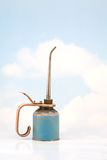 Old Oil Can on Sky Background royalty free stock photography