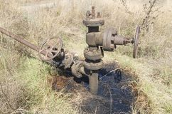 Old oil drilling on the meadow Royalty Free Stock Photography