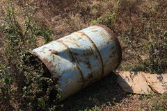 Old Oil Drum/Barrel left damaged on the ground Stock Image