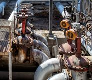 Old Oil and gas pipe line and valves Royalty Free Stock Photography