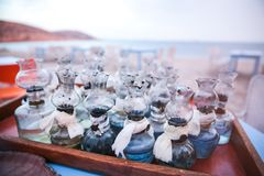 Old Oil Glass Lamps With DIY Fixes Gathered On Table On Greek Be Royalty Free Stock Images