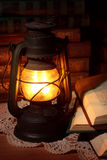 Old oil lamp. And old books Stock Photo