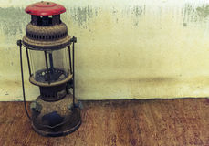 Old oil lamp on dark background. Stock Photo