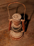 Old oil lamp. Isolated on wood background Stock Photos
