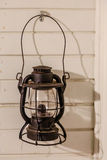 Old Oil Lamp on Wood Wall Royalty Free Stock Image