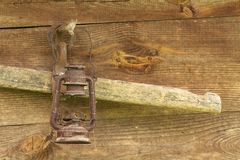 Old oil lantern on wooden wall Royalty Free Stock Images