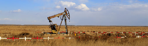 An old oil pump jack Royalty Free Stock Image