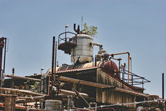 Old oil refinery. Old abandoned rusty oil refinery Royalty Free Stock Photography