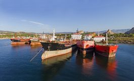 Old oil tanker vessels in a row stock photos