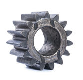 Old oiled damaged machine gear isolated Stock Photos