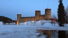 The old Olavinlinna castle, March twilight. Savonlinna, Finland. The old Olavinlinna castle in the March twilight. Savonlinna, Finland stock footage