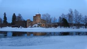 The old Olavinlinna castle in the March twilight. Savonlinna, Finland. The old Olavinlinna castle in the March twilight. Savonlinna. Finland stock video