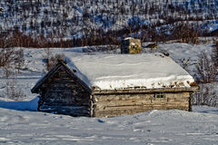 Old cabin on a wonderful sunny winter day. Royalty Free Stock Images