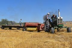 Old Oliver 1650 tractor and New Holland baler stock images