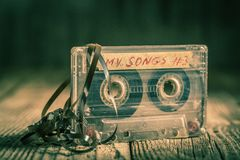 Old one cassette tape with an extracted tape Royalty Free Stock Images