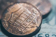 Old one cent coin. Business and Finance. Closeup of old one-cent coins. Coins and bills, the national currency of the United States. Income and expenses royalty free stock photos