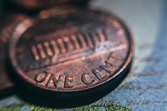 Old one cent coin. Business and Finance. Closeup of old one-cent coins. Coins and bills, the national currency of the United States. Income and expenses royalty free stock photo