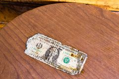 An old one dollar bill on a table. Stock Photo