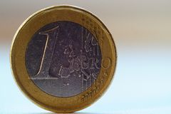 Old 1 one euro coin. Stands on blurred background royalty free stock image