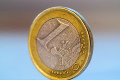 Old 1 one euro coin. Stands on blurred background royalty free stock photography