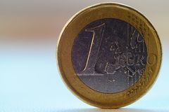 Old 1 one euro coin. Stands on blurred background royalty free stock photos