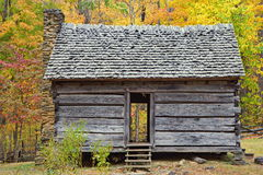 Old one room log cabin during Autumn in Smoky Moun Stock Photos