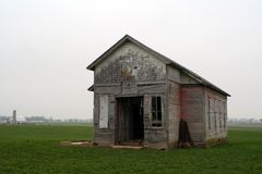 Old One Room School house. An old one room school house in a field on a cloudy day royalty free stock photos