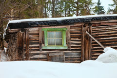 Old one-storey wooden house in the winter Royalty Free Stock Image