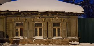 Old one-story wooden house on the street in winter. Russia, Tula 22,12,2018 Old one-story wooden house on the street in winter stock photography