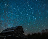 Old Ontario Barn and the night stars trailing Stock Photos