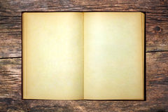 The old open book. And empty pages on wooden table Royalty Free Stock Photo