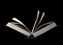 Old open book on a black background Stock Photography