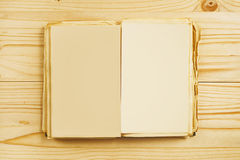 Old open book with blank pages from above Stock Images