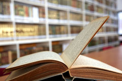 Old open book in library Stock Images