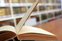 Old open book in library Royalty Free Stock Images