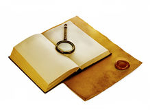 Old open book with loupe on vintage paper with a red wax seal. Royalty Free Stock Image