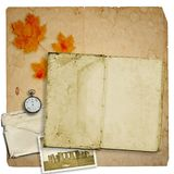 Old open book or photo album with pocket watch Stock Photo