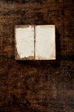 Old open book on the table Royalty Free Stock Images