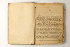 Old open book with text. Royalty Free Stock Photography