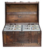 Old open chest filled with stacks of bundles of 100 US dollars. Royalty Free Stock Image