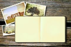 Old open diary book on weathered wood. Stock Photos