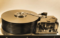 Old open hard disk drive. Stack of ten platters and magnetic hea Stock Photo