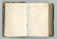 Old open notebook with yellowed pages. Stock Image