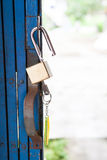 Old open padlock and key Stock Photography