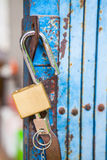 Old open padlock and key Stock Photo
