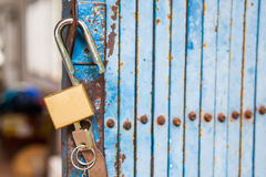 Old open padlock and key Stock Images