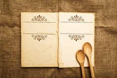 Old open recipe book. Vintage open recipe book with old grunge paper textured pages Royalty Free Stock Photography