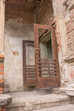 Old open rusty iron door Royalty Free Stock Image