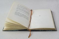 Old Open Vintage blue book with bookmark Royalty Free Stock Photo